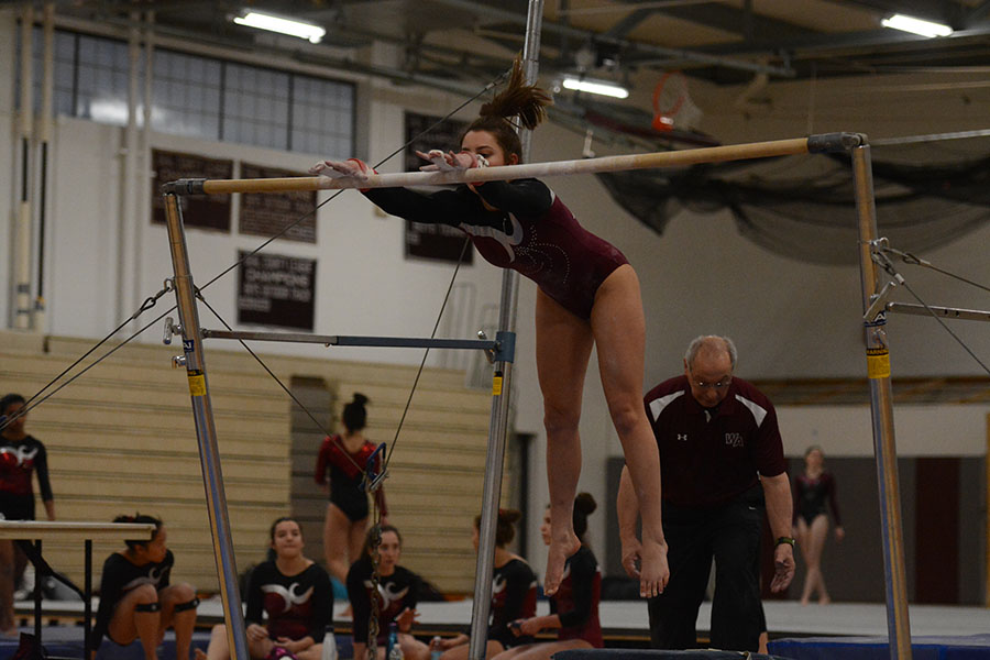 Senior+Jelina+Farrell%2C+practicing+her+routine+on+the+even+bars.