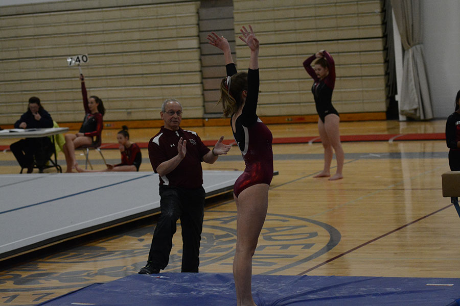 Senior+Captain+Hannah+Kettering+in+finishing+pose+after+completing+her+routine