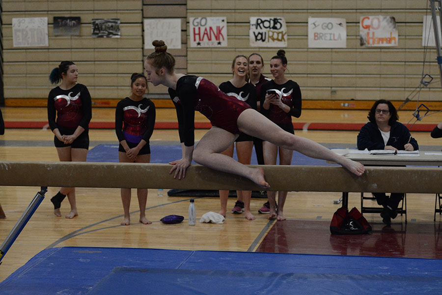 Freshman+Erin+Cragg+hoisting+herself+up+to+get+ready+for+her+routine