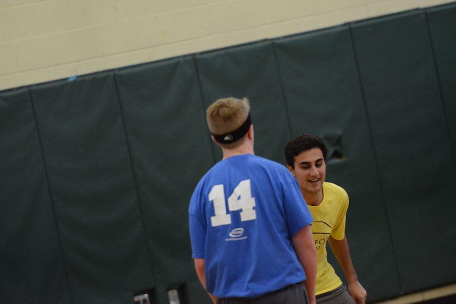 Senior Nayan Jani plays tough defense on Nick Furness.
