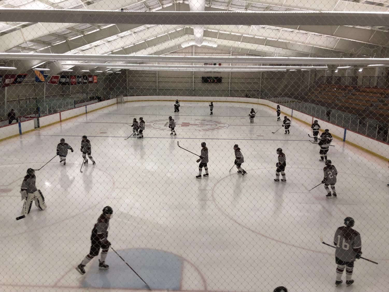 The WA Girls' Hockey Team warms up before the third period.