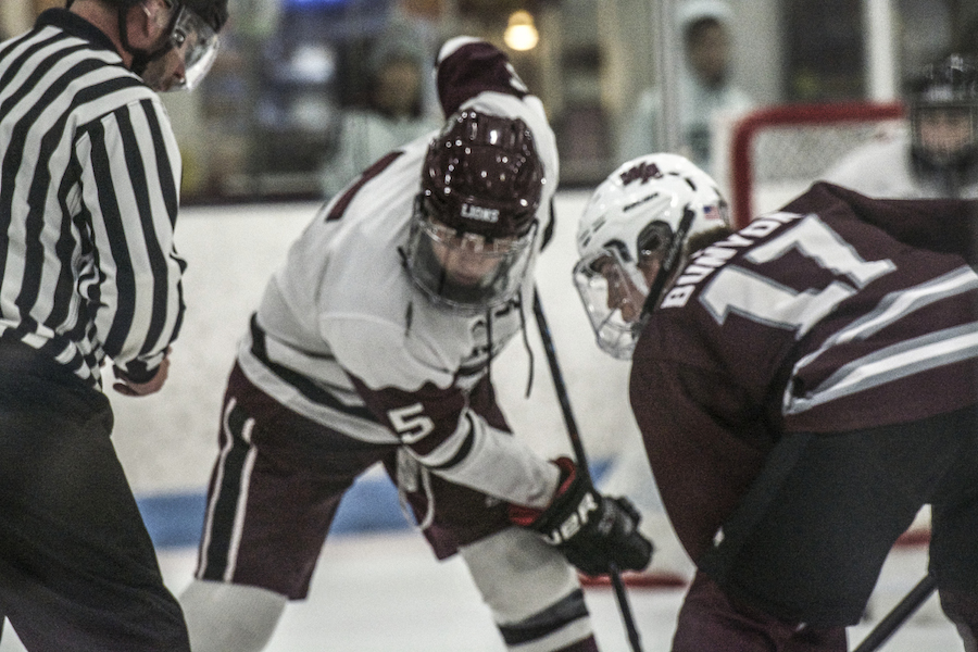Sophomore forward player Jason Bunyon faces off with a Chelmsford player at the start of the second period.