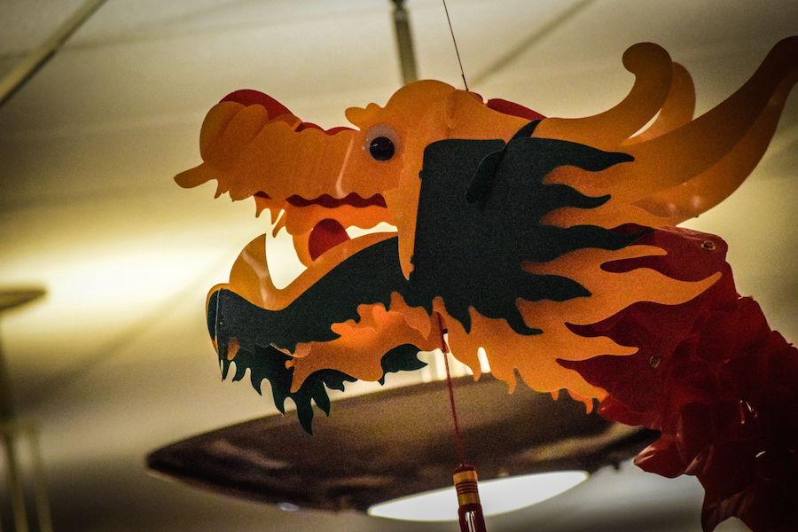 Decorative+dragon+streamers+hang+in+the+cafe%2C+adding+a+festive+appearance+to+the+room.