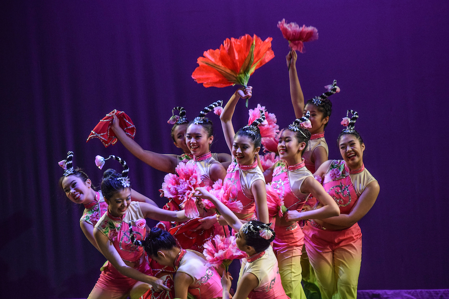 Chinese+Folk+Art+Workshop+performers+finish+their+%22Among+the+Flowers%22+dance+with+a+pose.