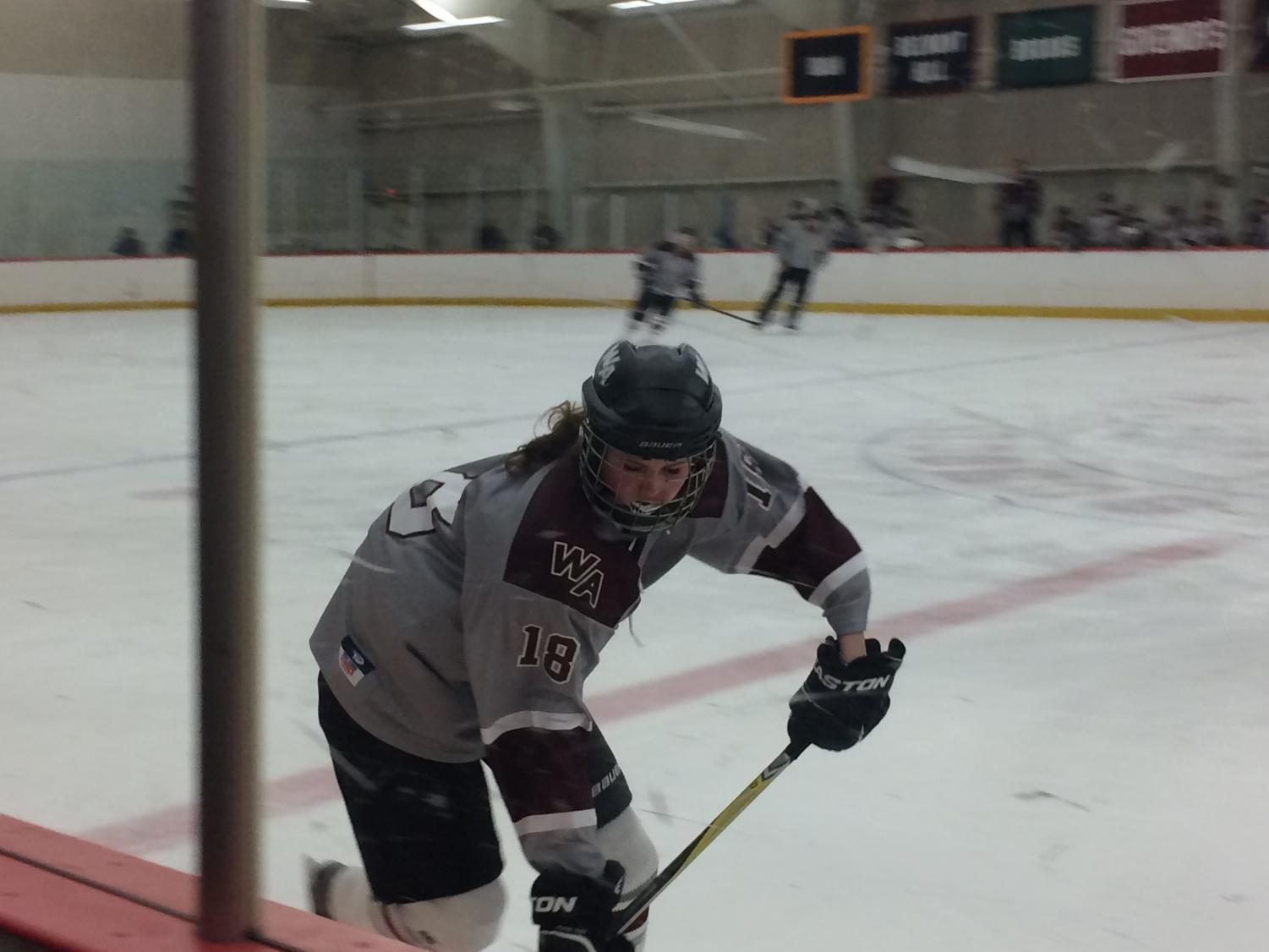 Nothing+but+hard+work+shown+in+Katie+Popp%27s+face+as+she+takes+the+puck+up+the+ice