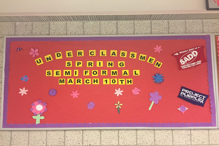 The SADD and Project Purple board outside Melanie Jozokos's class.  The board is broadcasting information about the upcoming underclassmen spring dance.