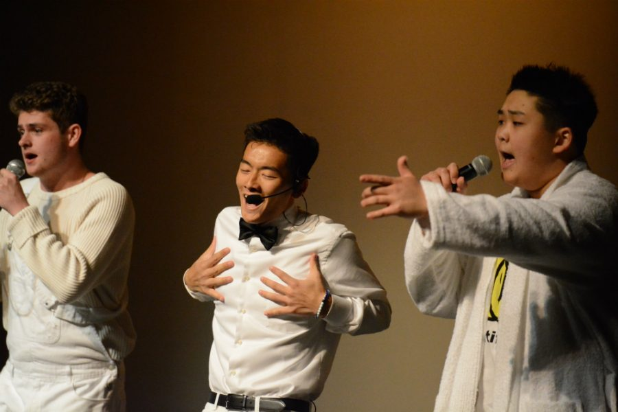 (Left to right) Seniors Ryan  Wasylyshyn, Steven Okuhara, and Ian Kim take the audience back to the 90s with their cover of