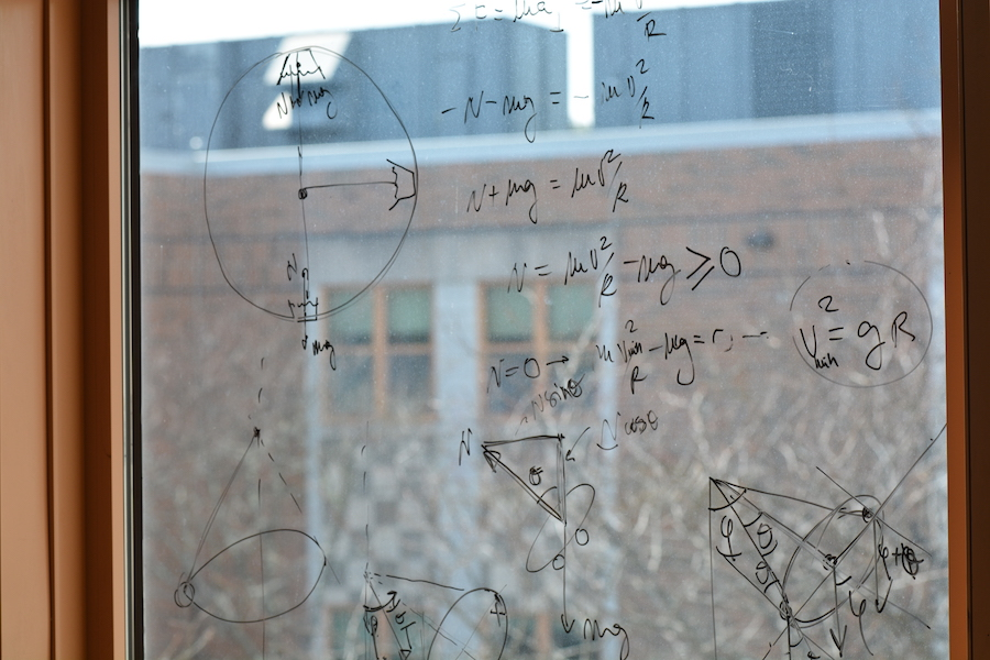 Physics instruction spreads from the whiteboard to the windows.
