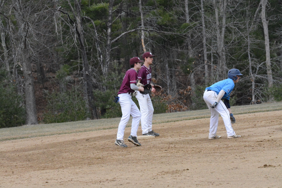 Sophomore+infielders+Jason+Fitzgerald+and+Kevin+Egan+work+together+to+hold+the+baserunner+near+the+bag.