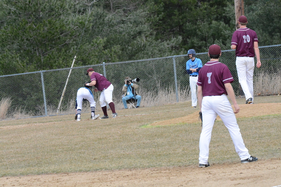 First+basemen+Ian+Kim+nearly+completes+the+pick+off+of+the+Dracut+player.
