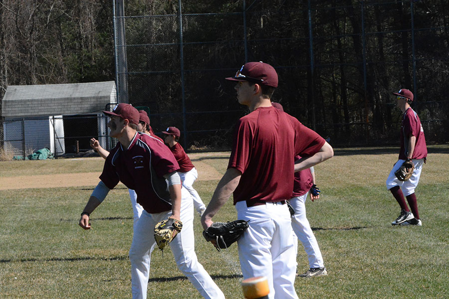 WA+Boys+Varsity+Baseball+team+practicing+their+throws+before+the+game.