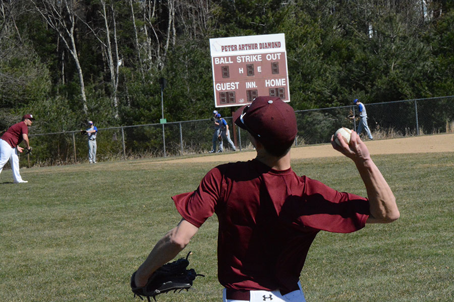 Senior+Sean+Egan+throwing+a+ball+during+practice+in+the+outfield.+