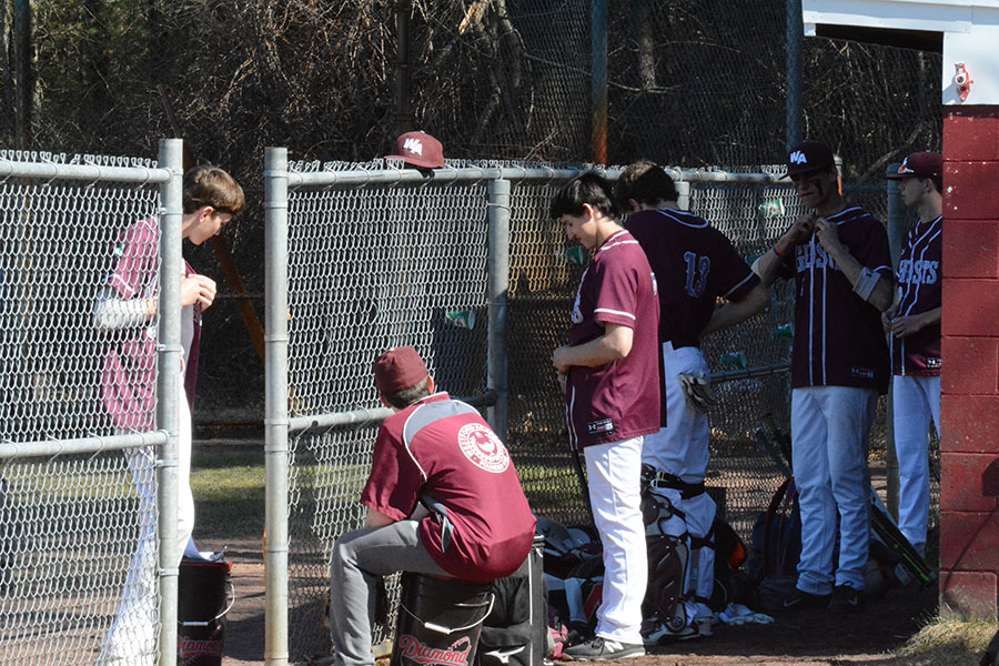 WA%27s+Varsity+Baseball+team+getting+their+gear+on+before+the+game.