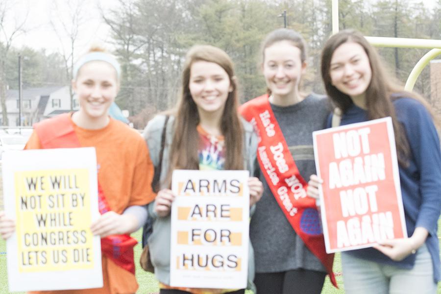 Sophomores%2C+Emily+Blagg%2C+Cordelia+Redmond%2C+and+Caroline+Burke+holding+signs.+