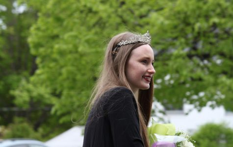 Last year's Queen, Olivia Overington, arrives to pass on her crown.