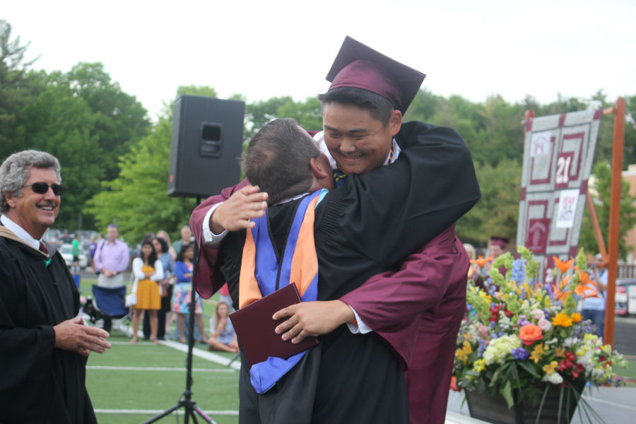 Class+of+2018+President+Ian+Kim+hugs+Principal+Jim+Antonelli+after+receiving+his+diploma.