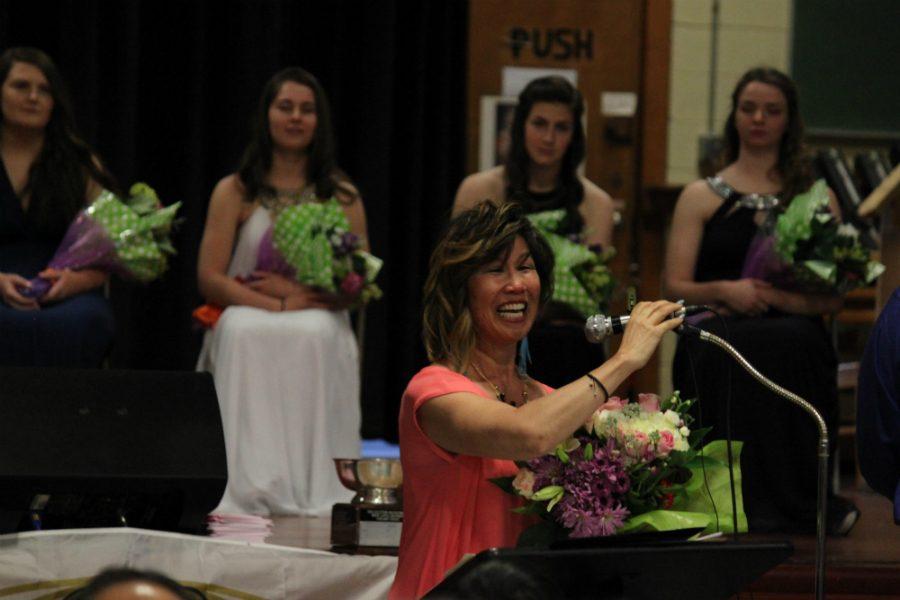 Gloria Tu Gilbert receives the Kiwanis Person of the Year Award.