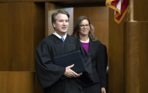 President Donald Trump's Supreme Court nominee, Judge Brett Kavanaugh, officiates at the swearing-in of Judge Britt Grant, right, to take a seat on the U.S. Court of Appeals for the Eleventh Circuit, Tuesday, Aug. 7, 2018, at the U.S. District Courthouse in Washington. (AP Photo/J. Scott Applewhite)