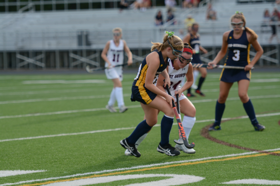 Olivia+Beatty+jostles+an+AB+player+for+the+ball.+