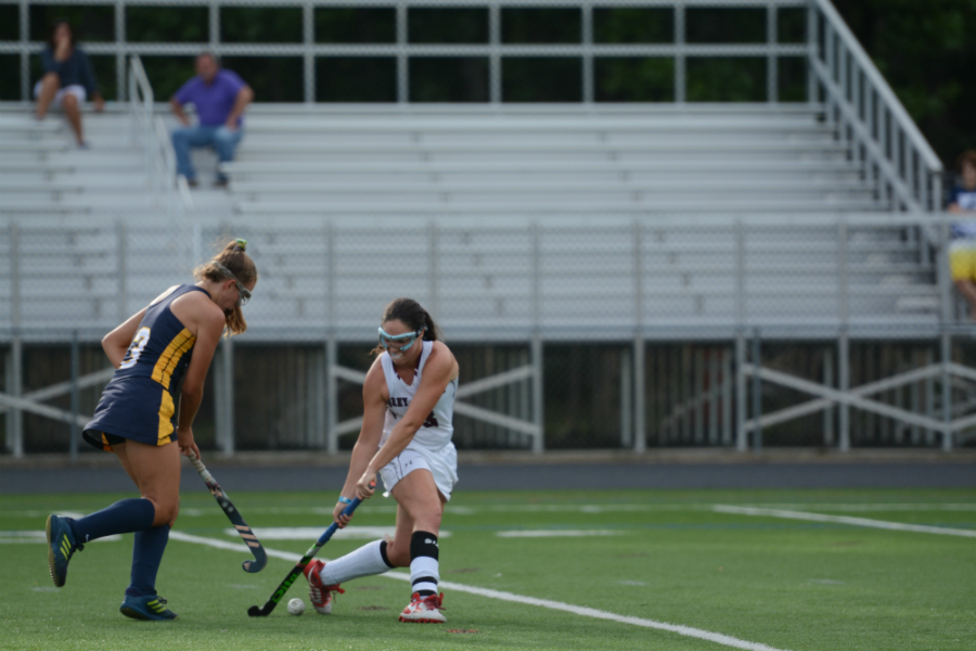 Senior+Olivia+Vallone+keeps+the+ball+away+from+an+AB+player.+
