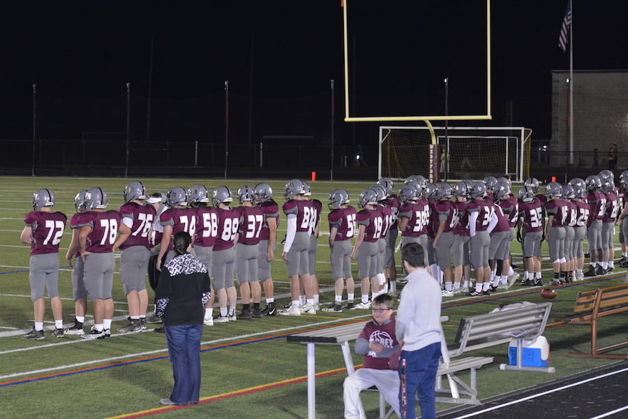 Ghosts+on+the+sideline+lining+up+while+the+captains+meet.