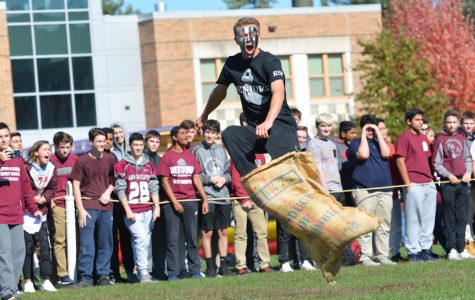 Senior Cole Mazzaferro jumps for joy after winning the potato sack race.