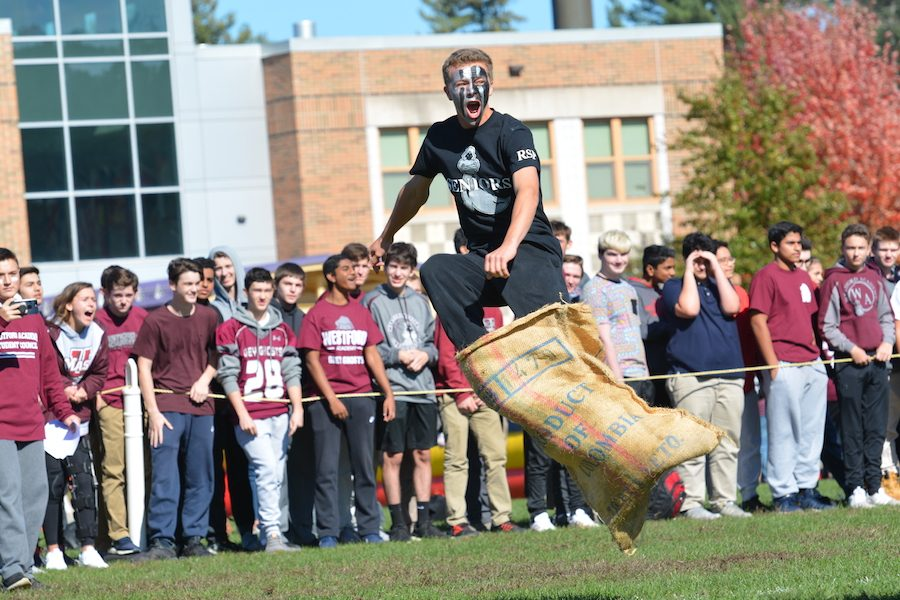 Senior+Cole+Mazzaferro+jumps+for+joy+after+winning+the+potato+sack+race.