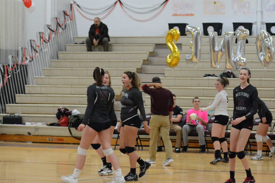 The+Girls%27+Volleyball+team+enters+the+gym+to+play+Cambridge+Rindge+%26+Latin.