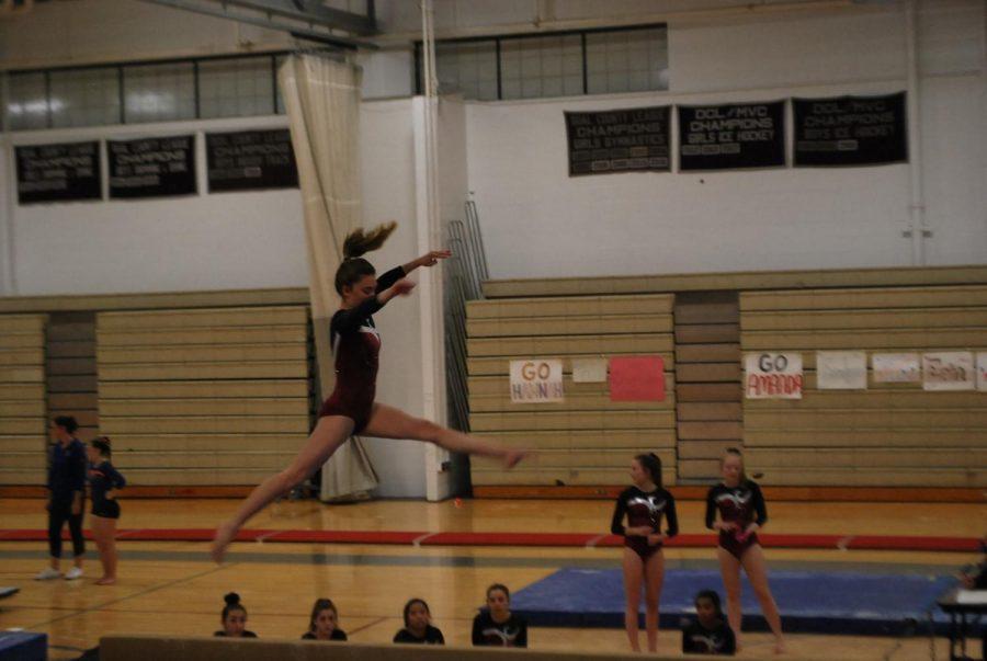 Eleanor Cioffi doing the leap on the balance beam