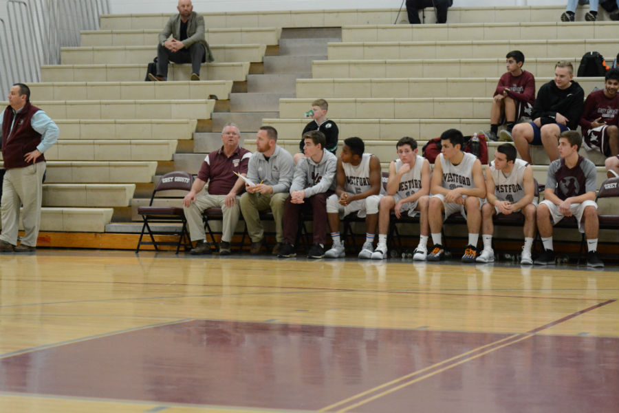 WA+players+and+coaches+on+the+sidelines%2C+watching+the+game+ensue.