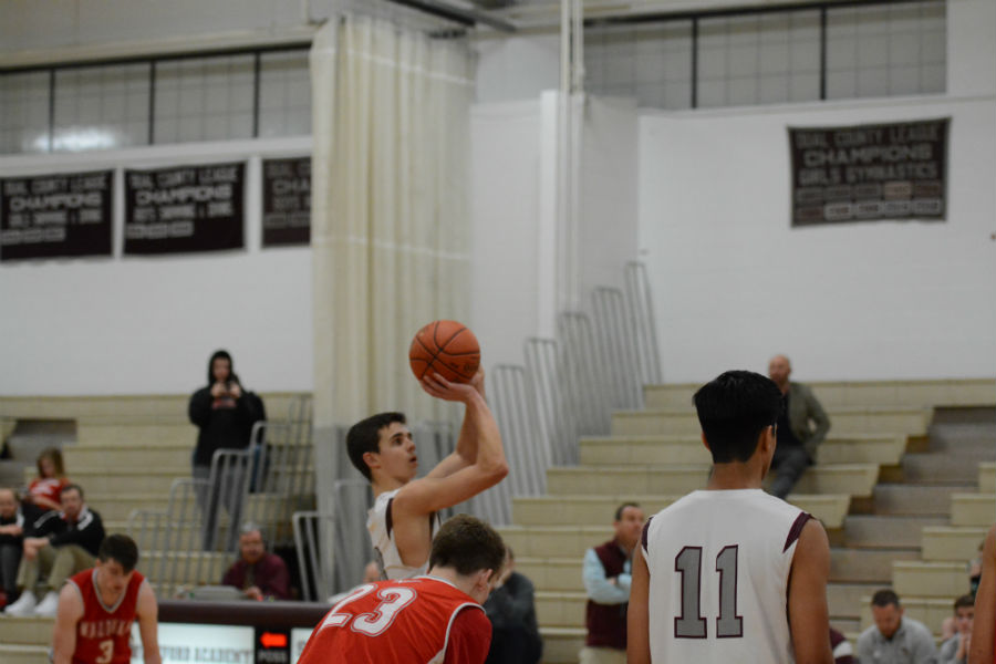 Senior+co-captain+Ben+Lawrence+as+he+attempts+to+make+a+free-throw.