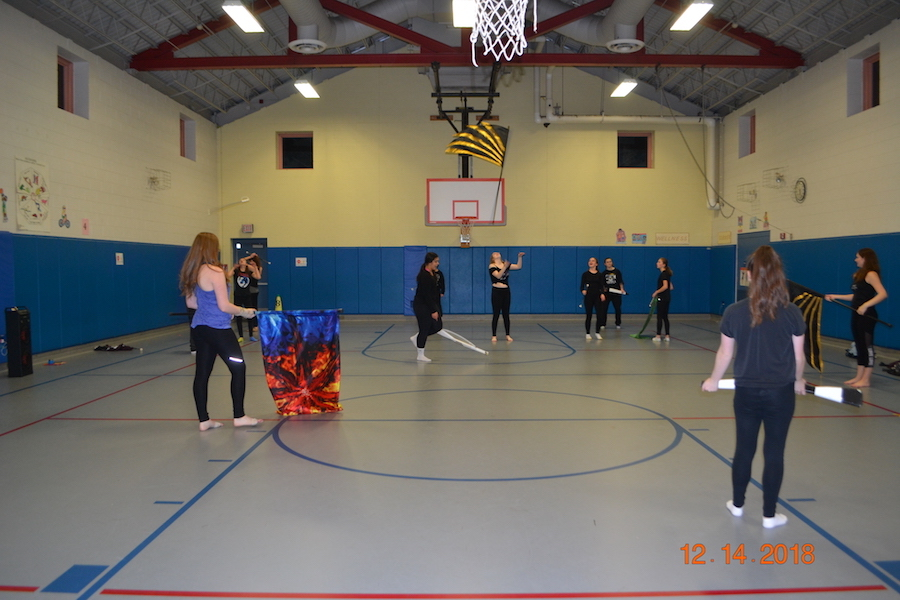 Team+practices+their+use+of+props+in+the+Nabnasset+Elementary+School+gym