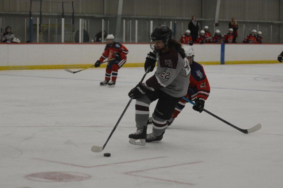 Captain Kayleigh Butler skates down the rink.