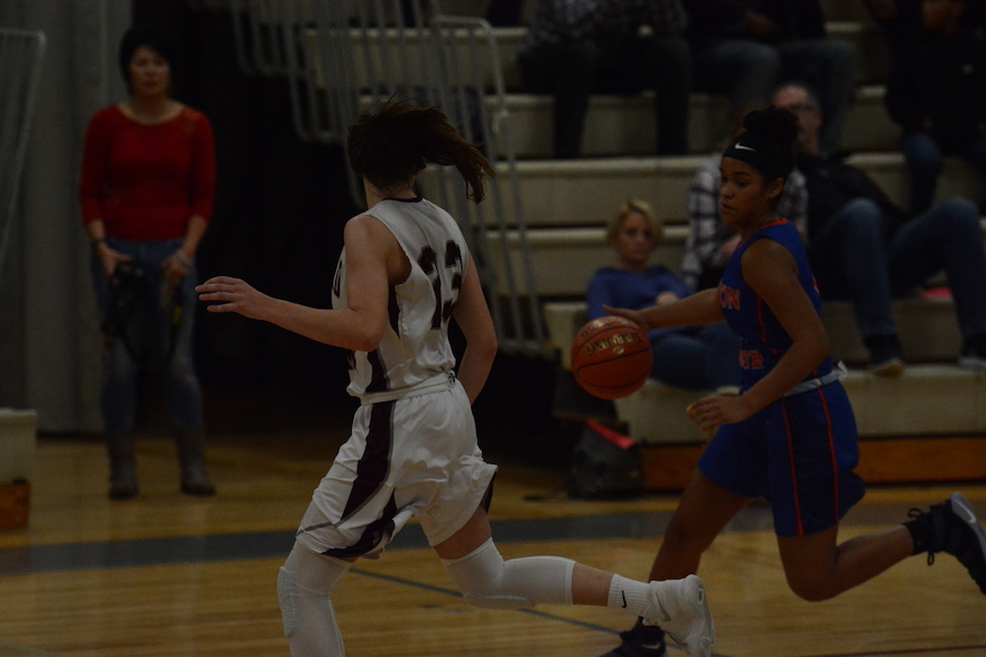 Westford+Academy%27s+Brooke+Pillsbury+runs+across+the+court%2C+in+an+attempt+to+guard+the+ball.