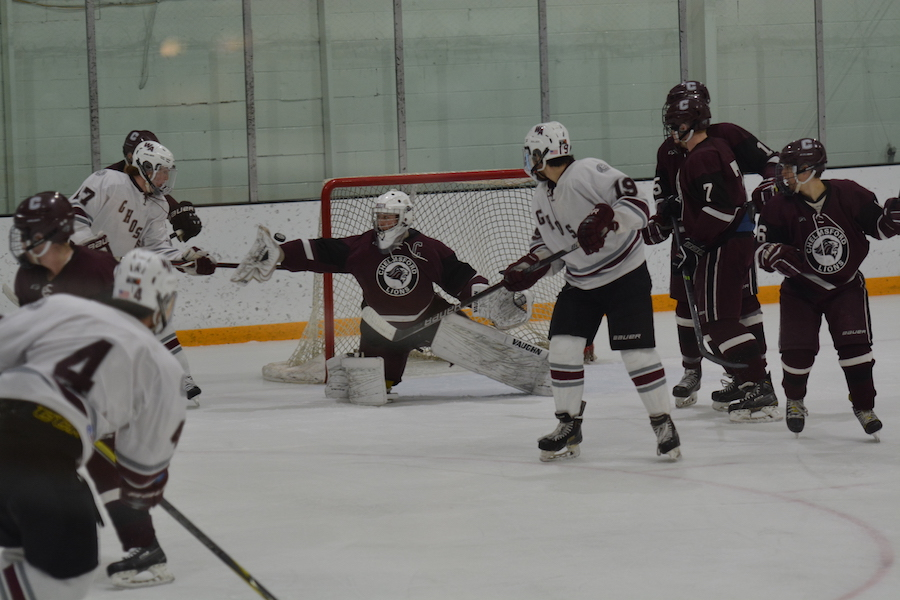 Chelmsford%27s+goalie+attempts+to+stop+a+puck+shot+by+number+4%2C+senior+Jack+Sepe.