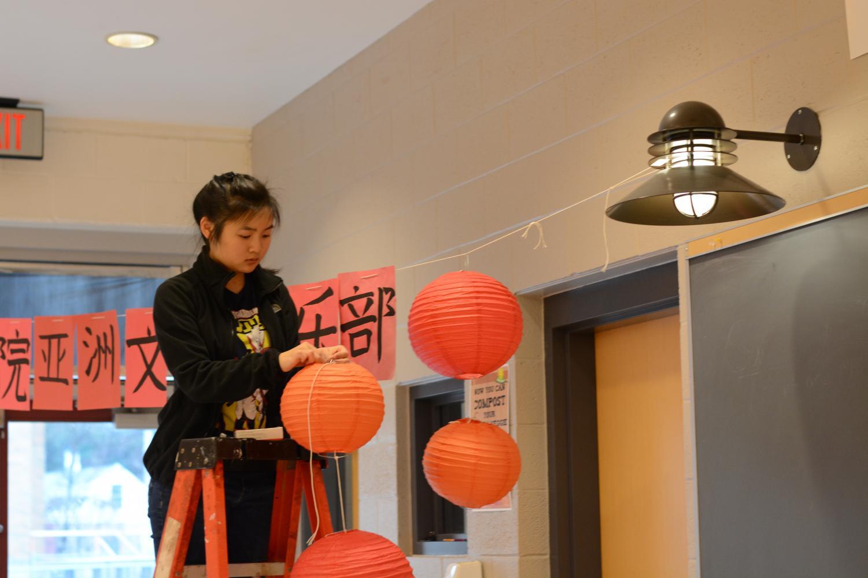 Mandarin+club+sets+up+lanterns+outside+their+booth.