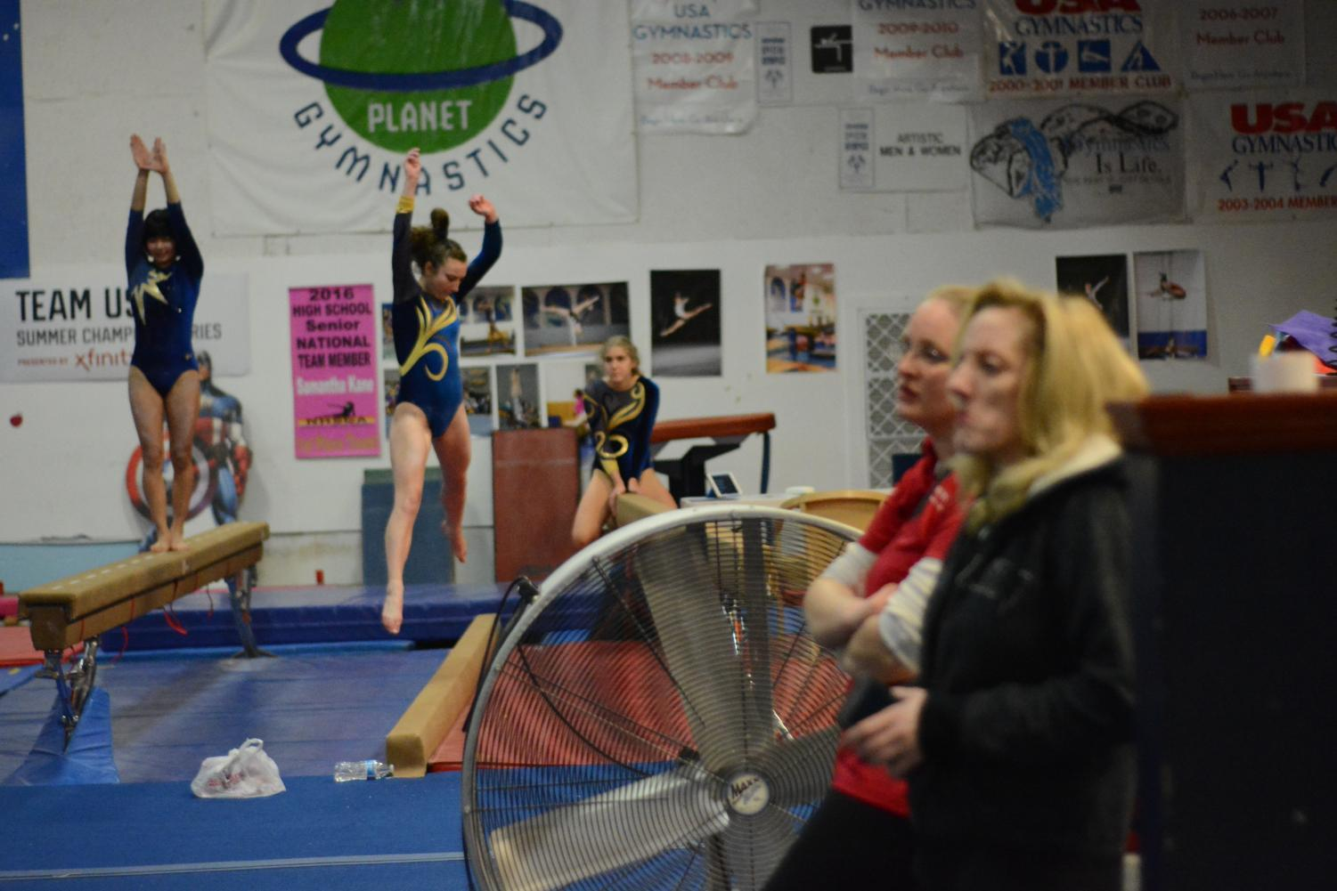 Acton+Boxborough+gymnasts+performing+in+the+beam+event.