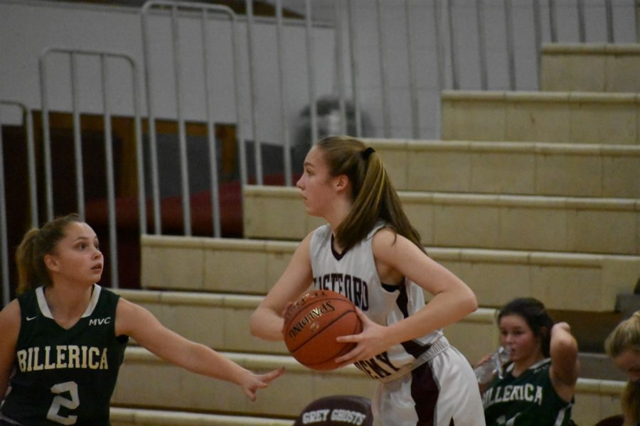 Sophomore Jennifer Martin attempts to dodge a Billerica player.