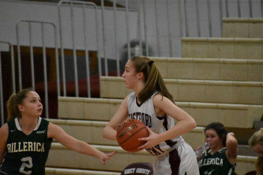Sophomore+Jennifer+Martin+attempts+to+dodge+a+Billerica+player.