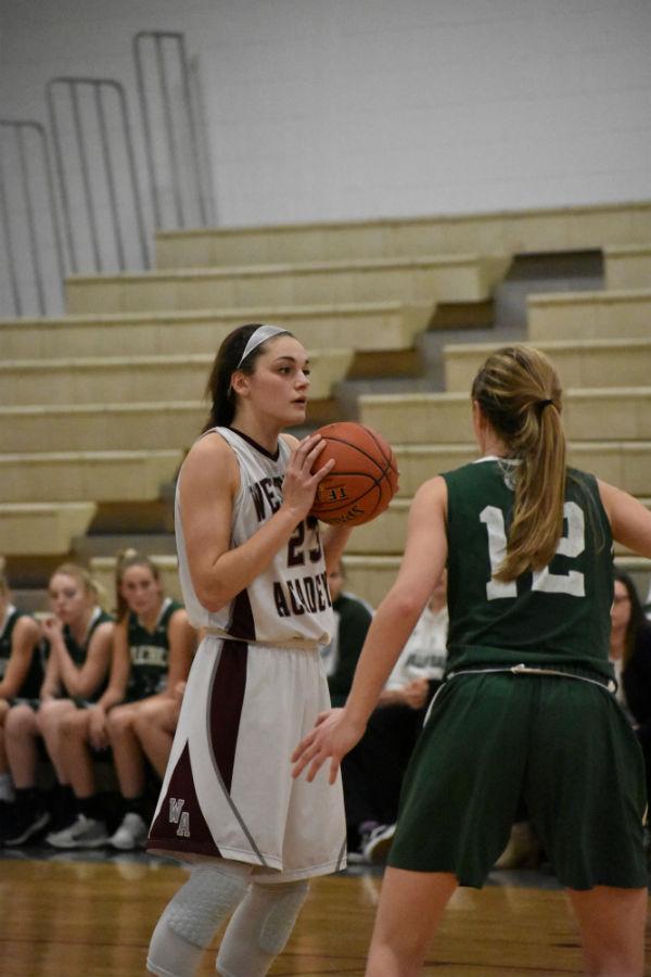 Senior+Brooke+Pillsbury+attempts+to+pass+a+Billerica+player.
