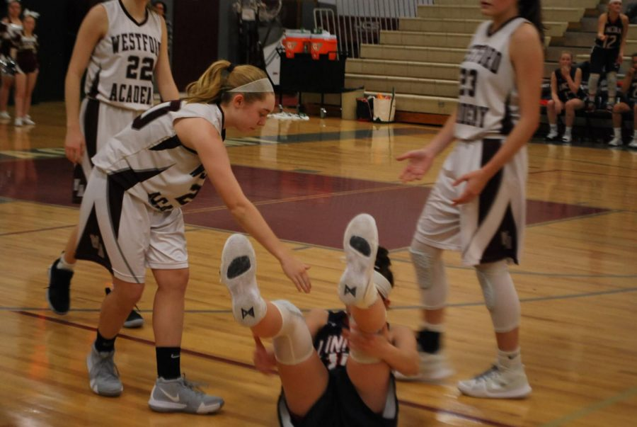 Carly Davey demonstrates that sportsmanship is the key to a good game.