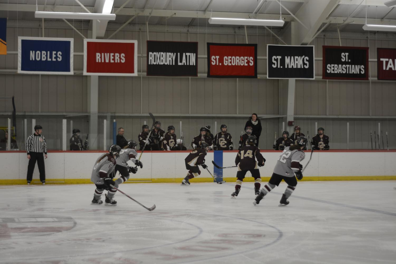 CC+steals+the+puck+away+from+a+Westford+Academy+forward.