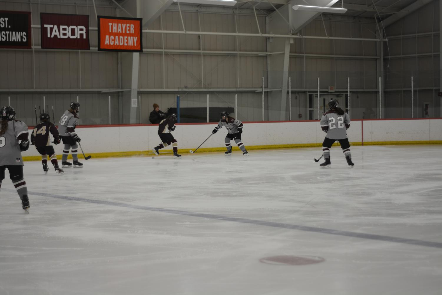 Westford+Academy+hustles+back+to+defend+their+side+of+the+ice.