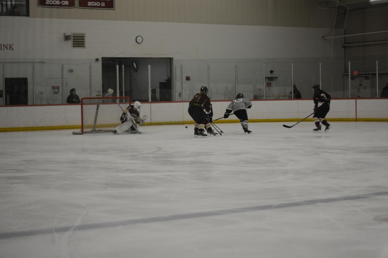 Senior+Brianna+Bailey+takes+a+shot+on+the+CC+goalie.