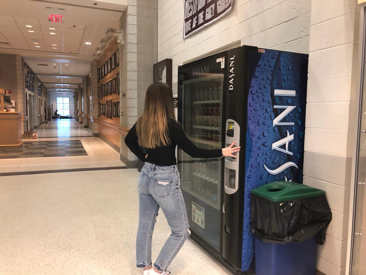 student buys a drink during ten minute break