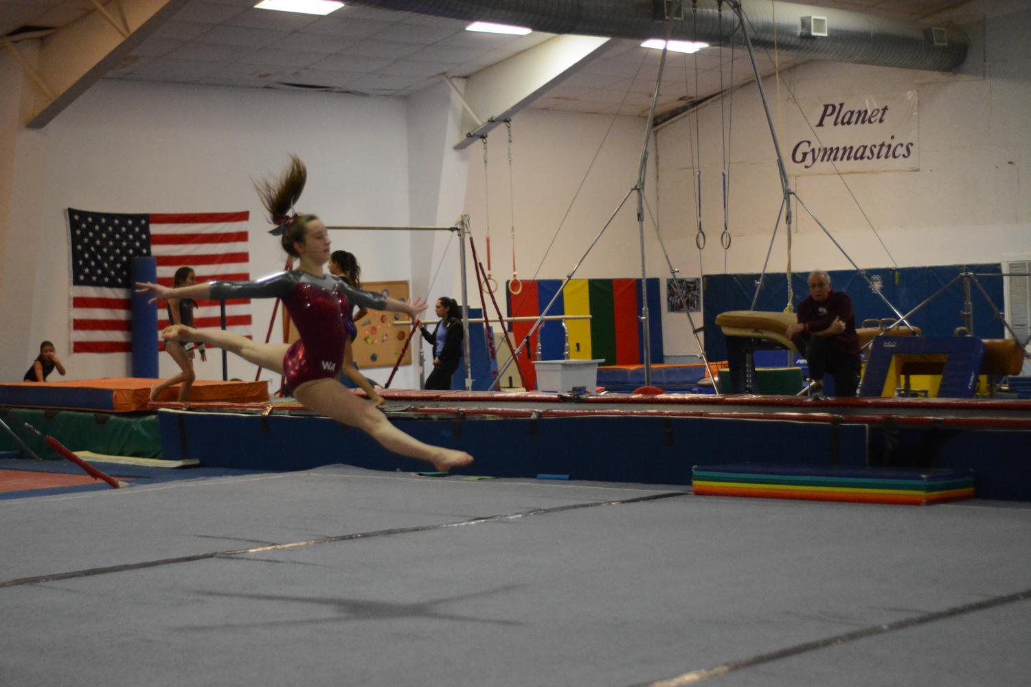 Sophomore+Kaitlin+Murphy+doing+a+leap+during+her+floor+event.
