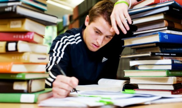 A student is stressed and overwhelmed with work.