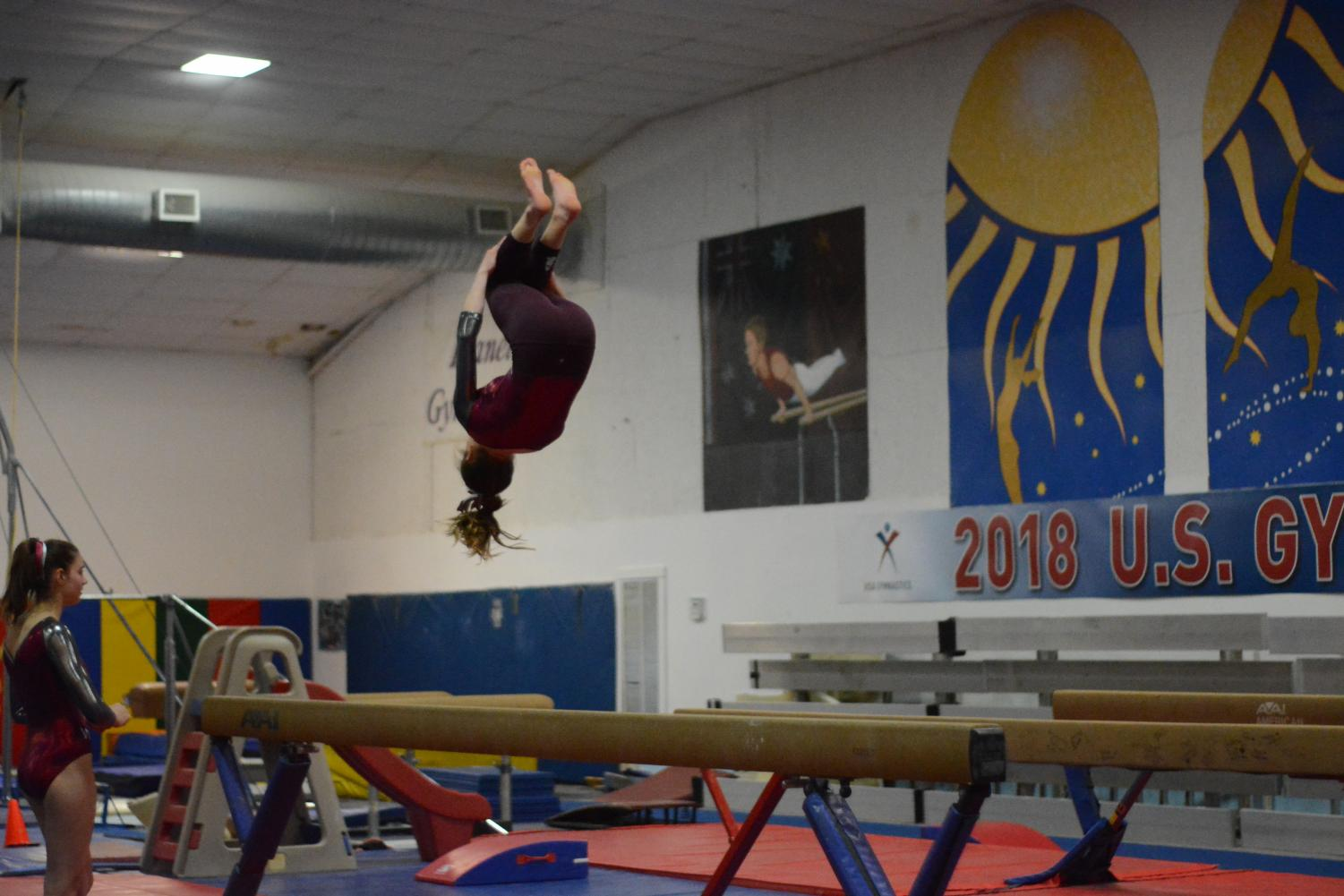 WA+gymnast+does+her+backflip+on+the+beam.
