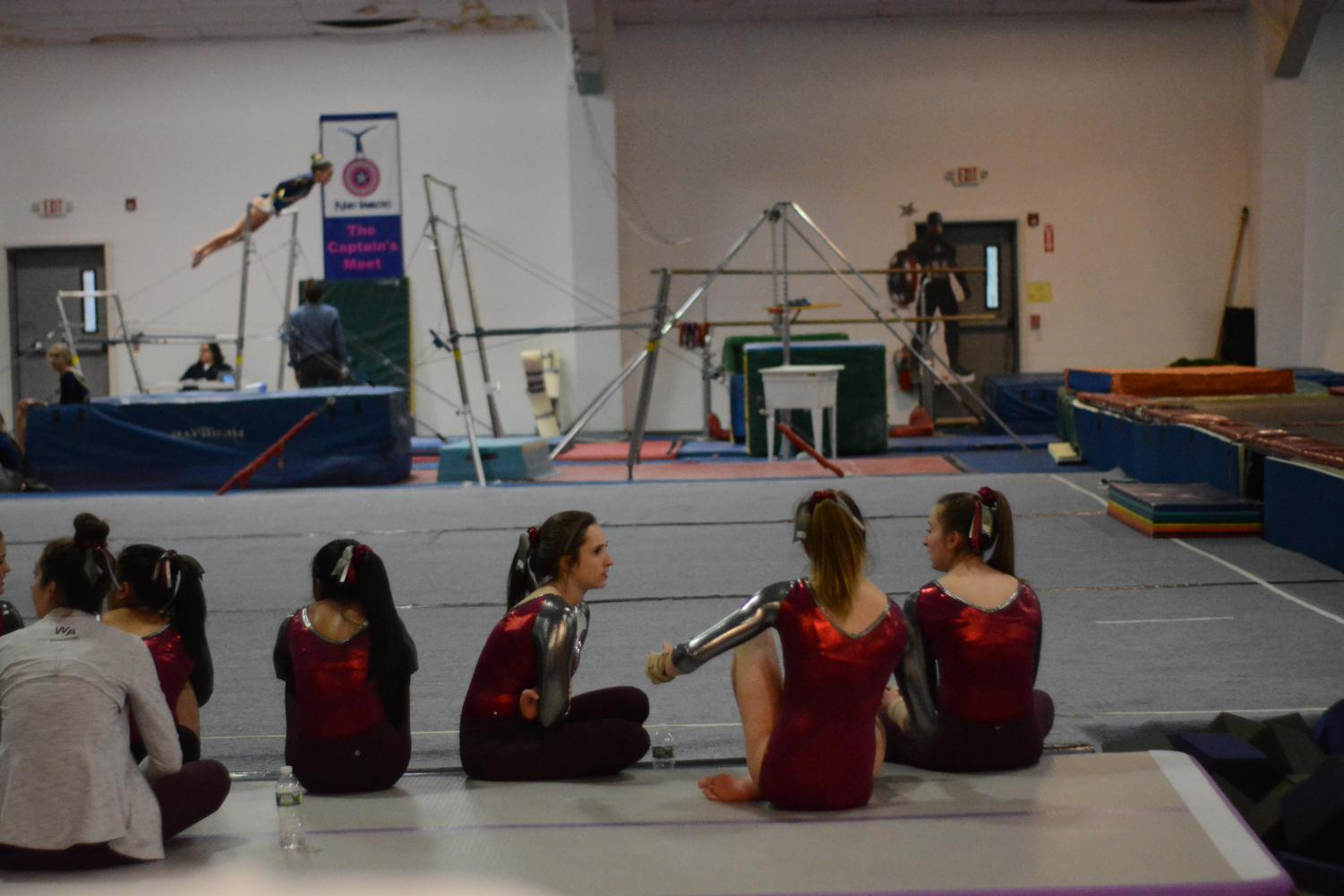 WA+gymnasts+talk+amongts+themselves+as+they+wait+for+their+turn+to+perform+in+the+on+floor+event.