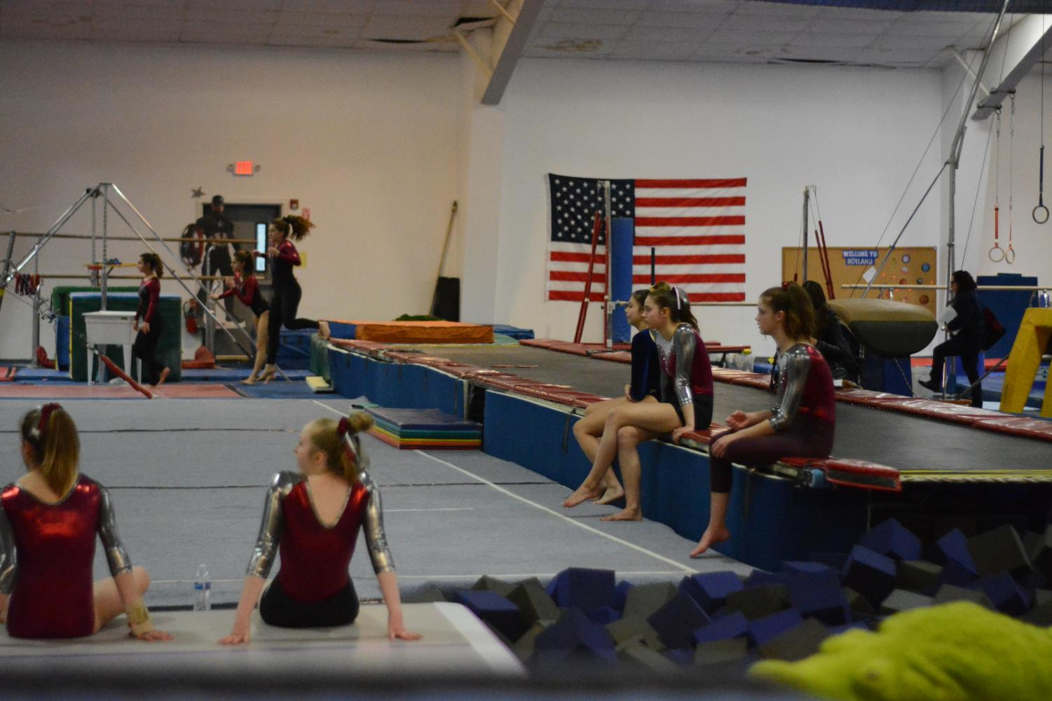 WA+gymnasts+watch+Groton+Dunstable+Regional+perform+in+their+floor+event.